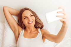 Beautiful woman in bed Royalty Free Stock Image