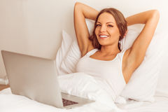 Beautiful woman in bed Stock Photography