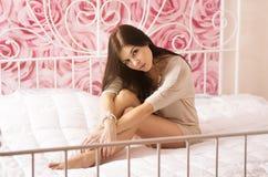 Beautiful woman in bedroom Stock Image
