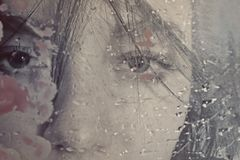 Beautiful woman behind wet glass Stock Photos