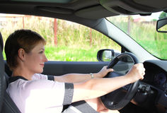 Beautiful woman behind the wheel Stock Images