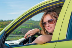 Beautiful woman behind the wheel Royalty Free Stock Photo