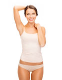 Beautiful woman in beige cotton underwear Royalty Free Stock Images
