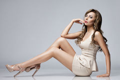 Beautiful woman. In beige dress royalty free stock images