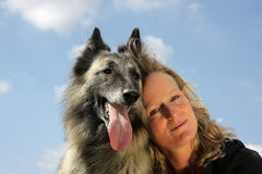 Beautiful woman with Belgian shepherd Stock Images
