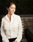Beautiful woman on a bench Stock Image