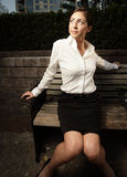 Beautiful woman on a bench Royalty Free Stock Photo