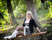 The beautiful woman on a bench in the park in the fall Royalty Free Stock Images