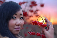 Beautiful woman with berry. In her hand royalty free stock photos