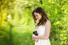 Beautiful woman with Bible. Is in sunny nature Stock Images