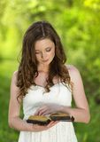 Beautiful woman with Bible Stock Photography