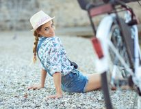 Beautiful woman with bicycle on the beach Stock Photos