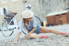 Beautiful woman with bicycle on the beach Royalty Free Stock Photos