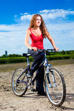 Beautiful woman with bicycle at the sea Royalty Free Stock Images