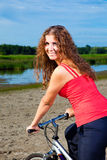 Beautiful woman with bicycle at the sea Royalty Free Stock Photography