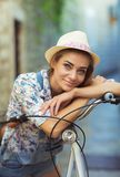 Beautiful woman with bicycle on street of old town Royalty Free Stock Photography
