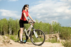 Beautiful woman bicyclist Stock Photos