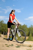 Beautiful woman bicyclist Stock Photo