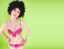 Beautiful woman in a big afro wig Stock Photos