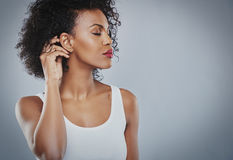 Beautiful woman with big black hair white shirt, Black woman royalty free stock photography