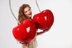 Beautiful woman with big cherry Royalty Free Stock Photos
