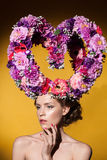Beautiful woman with big floral heart on her head. Royalty Free Stock Photography