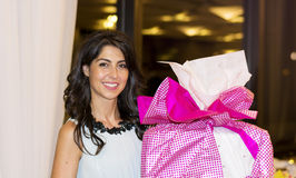 Beautiful woman with big gift in the hands Stock Images