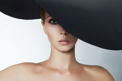 Beautiful woman in big hat Stock Photography