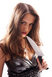 Beautiful woman with big knife Stock Photography