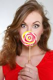 Beautiful woman with big lollipop Stock Photography