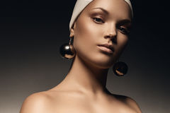 Beautiful woman with big mirror earrings Stock Photo