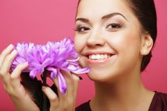 Beautiful woman with big purple flower Royalty Free Stock Photos