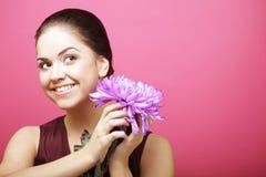 Beautiful woman with big purple flower Royalty Free Stock Image