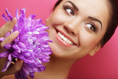 Beautiful woman with big purple flower Royalty Free Stock Photography