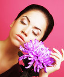 Beautiful woman with big purple flower Royalty Free Stock Images