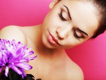 Beautiful woman with big purple flower Stock Images