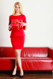Beautiful woman with big red gift. Royalty Free Stock Image