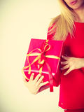 Beautiful woman with big red gift. Stock Image