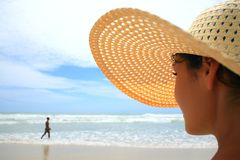 Woman wearing straw hat Royalty Free Stock Photos