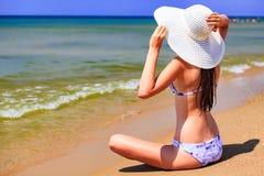 Beautiful woman in big straw sunhat sunbathing stock photography