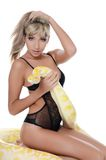 The beautiful woman with the big yellow snake Stock Photos