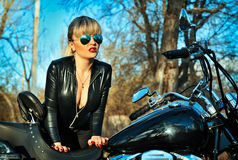 Beautiful woman on a bike Royalty Free Stock Photos