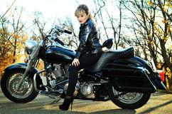 Beautiful woman on a bike Royalty Free Stock Photo