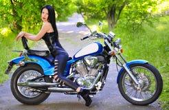 Beautiful woman on a bike Royalty Free Stock Image
