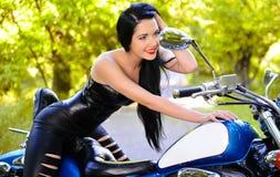 Beautiful woman on a bike Royalty Free Stock Photos