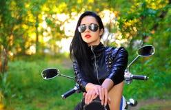 Beautiful woman on a bike Stock Image