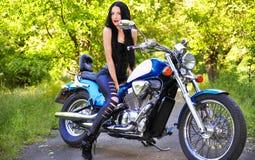 Beautiful woman on a bike Stock Images