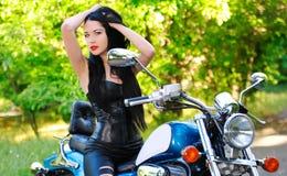 Beautiful woman on a bike Royalty Free Stock Photography