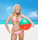 Beautiful woman in bikini with beach ball Stock Images