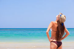 Beautiful woman in a bikini on the beach looking Royalty Free Stock Image